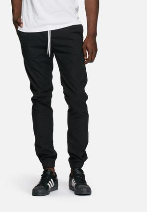 PRODUKT Slim Cuffed Jogger Pants & Chinos Black